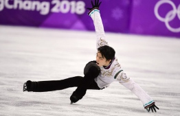Japan's Yuzuru Hanyu competes in the men's single skating free skating of the figure skating event during the Pyeongchang 2018 Winter Olympic Games at the Gangneung Ice Arena in Gangneung on February 17, 2018. / AFP PHOTO / Roberto SCHMIDT
