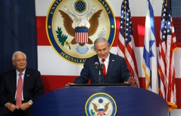 US ambassador to Israel David Friedman listens as Israel's Prime Minister Benjamin Netanyahu delivers a speech during the opening of the US embassy in Jerusalem on May 14, 2018. The United States moved its embassy in Israel to Jerusalem after months of global outcry, Palestinian anger and exuberant praise from Israelis over President Donald Trump's decision tossing aside decades of precedent. MENAHEM KAHANA / AFP