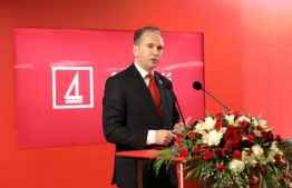 Bank of Maldives' CEO Andrew Healy speaking at a press conference.