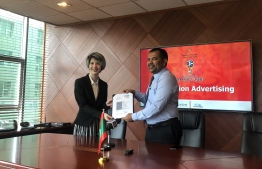 Tourism Minister Moosa Zameer (R) awards the project to advertise the Maldives in Moscow during World Cup Russia to Cabvertising Europe. PHOTO: ALI SHINAN/MIHAARU