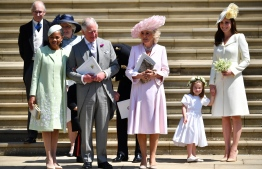 (L-R) Meghan Markle's mother Doria Ragland, Britain's Prince Charles, Prince of Wales, Britain's Camilla, Duchess of Cornwall, Princess Charlotte and Britain's Catherine, Duchess of Cambridge leave the wedding ceremony of Britain's Prince Harry, Duke of Sussex and US actress Meghan Markle at St George's Chapel, Windsor Castle, in Windsor, on May 19, 2018. Ben STANSALL / POOL / AFP