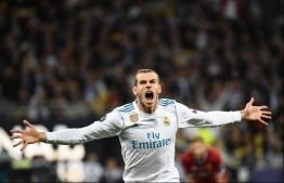 Real Madrid's Welsh forward Gareth Bale celebrates after scoring his team's second goal  during the UEFA Champions League final football match between Liverpool and Real Madrid at the Olympic Stadium in Kiev, Ukraine, on May 26, 2018. / AFP PHOTO / FRANCK FIFE