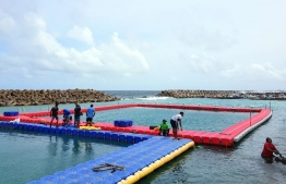 Staff of the Swimming Association and MNDF officers pictured during the repairs of Male Swimming Track's platforms. PHOTO/SWIMMING ASSOCIATION