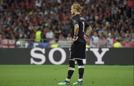 Liverpool's German goalkeeper Loris Karius reacts during the UEFA Champions League final football match between Liverpool and Real Madrid at the Olympic Stadium in Kiev, Ukraine on May 26, 2018. / AFP PHOTO / LLUIS GENE