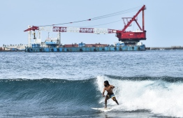 Surfing during the construction phase of the bridge; a number of local surfers have expressed their dismay upon the banning and have filed several complaints. PHOTO: MIHAARU