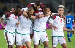 Morocco's team celebrates the second goal during their international friendly football match between Morocco and Uzbekistan at the Mohammed V Casablanca Stadium in Casablanca on March 27, 2018. / AFP PHOTO / FADEL SENNA