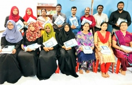 "Teachers of Vandhoo School with the new tablets: The education ministry brought over 70,000 ""Vave"" tablets in their effort to digitise all the schools across Maldives. PHOTO: MINISTRY OF EDUCATION"