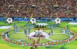Actors perform during the Opening Ceremony before the Russia 2018 World Cup Group A football match between Russia and Saudi Arabia at the Luzhniki Stadium in Moscow on June 14, 2018. / AFP PHOTO / Mladen ANTONOV /