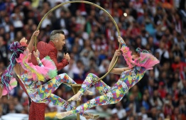 English singer Robbie Williams (C) performs during the Opening Ceremony before the Russia 2018 World Cup Group A football match between Russia and Saudi Arabia at the Luzhniki Stadium in Moscow on June 14, 2018. / AFP PHOTO / Kirill KUDRYAVTSEV /