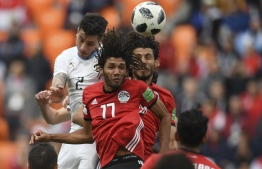 Uruguay's defender Jose Gimenez (L) rises above the Egyptian defence to head the ball and score the opening goal during the Russia 2018 World Cup Group A football match between Egypt and Uruguay at the Ekaterinburg Arena in Ekaterinburg on June 15, 2018. / AFP PHOTO / JORGE GUERRERO /