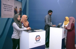 Employees of Maldives Pension Administration Office at an event held to provide information about the Retirement Pension Scheme. PHOTO: MIHAARU