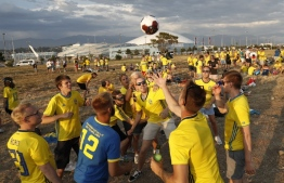 Swedish football fans celebrate midsummer outside the Fisht Olympic stadium in Sochi on June 22, 2018, on the eve of the Russia 2018 FIFA World Cup Group F football match between Germany and Sweden. / AFP PHOTO / Adrian DENNIS