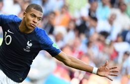France's forward Kylian Mbappe celebrates after scoring their four goal during the Russia 2018 World Cup round of 16 football match between France and Argentina at the Kazan Arena in Kazan on June 30, 2018. / AFP PHOTO / FRANCK FIFE /