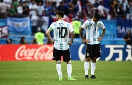 Argentina's forward Lionel Messi (L) and Argentina's midfielder Ever Banega react to their loss during the Russia 2018 World Cup round of 16 football match between France and Argentina at the Kazan Arena in Kazan on June 30, 2018. / AFP PHOTO / Jewel SAMAD /