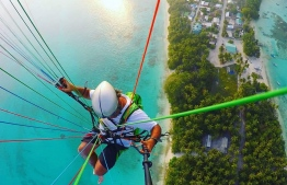 Soar through the sky over the glittering jewel tones of Maldives' archipelago, sun-kissed by the warm tropical rays with Maldives Paragliding. PHOTO/ MALDIVES PARAGLIDING