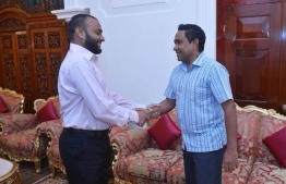 President Abdulla Yameen shakes hands with Dr. Mohamed Shaheem Ali Saeed, who was appointed as the president's running mate for the Presidential Election 2018.
