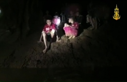 This handout video grab taken from footage released by the Royal Thai Navy late July 2, 2018, shows missing children inside the Tham Luang cave of Khun Nam Nang Non Forest Park in the Mae Sai district of Chiang Rai province.