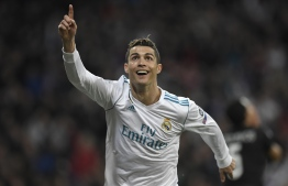 "(FILES) In this file photo taken on February 14, 2018 Real Madrid's Portuguese forward Cristiano Ronaldo celebrates after scoring his second goal during the UEFA Champions League round of sixteen first leg football match Real Madrid CF against Paris Saint-Germain (PSG) at the Santiago Bernabeu stadium in Madrid on February 14, 2018.   Real Madrid announced on July 10, 2018 the transfer of Cristiano Ronaldo to Italy's Juventus, with the Portuguese superstar saying the time had come ""for a new stage"" in his life. / AFP PHOTO / GABRIEL BOUYS"