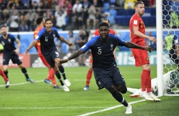 France's defender Samuel Umtiti celebrates scoring the opening goal during the Russia 2018 World Cup semi-final football match between France and Belgium at the Saint Petersburg Stadium in Saint Petersburg on July 10, 2018. / AFP PHOTO / CHRISTOPHE SIMON /
