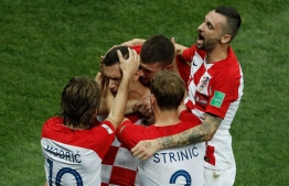 Croatia's forward Ivan Perisic celebrates with teammates after scoring a goal during the Russia 2018 World Cup final football match between France and Croatia at the Luzhniki Stadium in Moscow on July 15, 2018. / AFP PHOTO / Adrian DENNIS /