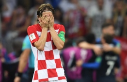Croatia's midfielder Luka Modric reacts after his team conceded a goal during the Russia 2018 World Cup final football match between France and Croatia at the Luzhniki Stadium in Moscow on July 15, 2018. / AFP PHOTO / Kirill KUDRYAVTSEV /