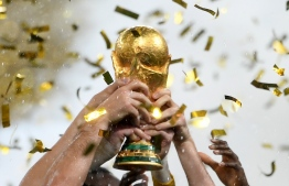 France's players lift the Fifa World Cup trophy after the Russia 2018 World Cup final football match between France and Croatia at the Luzhniki Stadium in Moscow on July 15, 2018. France won the World Cup for the second time in their history after beating Croatia 4-2 in the final in Moscow's Luzhniki Stadium on Sunday. / AFP PHOTO / Jewel SAMAD /