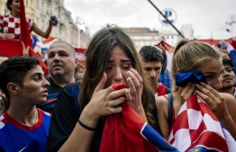 Croatian supporters react during the 2018 Russia World Cup final football match between Croatia and France, the first final World Cup match ever in the history of Croatia. / AFP PHOTO / DIMITAR DILKOFF