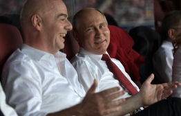 Russian President Vladimir Putin and FIFA president Gianni Infantino attend the Russia 2018 World Cup final football match between France and Croatia at the Luzhniki Stadium in Moscow on July 15, 2018. / AFP PHOTO / SPUTNIK / Alexey NIKOLSKY /