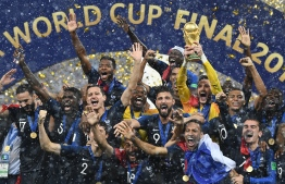 France's players celebrate as they hold their World Cup trophy during the trophy ceremony at the end of the Russia 2018 World Cup final football match between France and Croatia at the Luzhniki Stadium in Moscow on July 15, 2018. / AFP PHOTO / FRANCK FIFE /