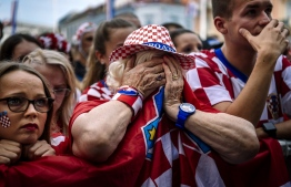 Croatian supporters react after the 2018 Russia World Cup final football match between Croatia and France, on July 15, 2018 in Zagreb the first final World Cup match ever in the history of Croatia. / AFP PHOTO / DIMITAR DILKOFF
