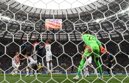 Croatia's forward Mario Mandzukic (5L) heads France's forward Antoine Griezmann's free kick into his own net scoring an own goal during their Russia 2018 World Cup final football match between France and Croatia at the Luzhniki Stadium in Moscow on July 15, 2018.  FRANCK FIFE / AFP