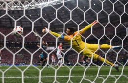 France's goalkeeper Hugo Lloris tries to save a shot during the Russia 2018 World Cup final football match between France and Croatia at the Luzhniki Stadium in Moscow on July 15, 2018.  Jewel SAMAD / AFP