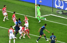 The ball goes in off of Croatia's forward Mario Mandzukic's head for the opening goal during the Russia 2018 World Cup final football match between France and Croatia at the Luzhniki Stadium in Moscow on July 15, 2018.  Mladen ANTONOV / AFP