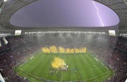 Lightning strikes as France players celebrate after the Russia 2018 World Cup final football match between France and Croatia at the Luzhniki Stadium in Moscow on July 15, 2018. France won the World Cup for the second time in their history after beating Croatia 4-2 in the final in Moscow's Luzhniki Stadium on Sunday. François-Xavier MARIT / AFP