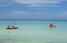 Take a fun canoeing excursion at Reveries Diving Village at L.Gan. PHOTO: REVERIES DIVING VILLAGE / THE EDITION
