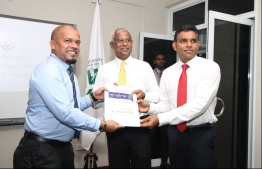 Opposition coalition candidate and running mate handing over their candidacy application to the Elections Commission President Ahmed Shareef. PHOTO: MDP