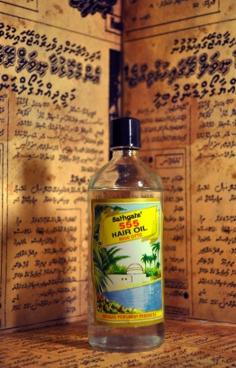 A modest shell that comes with a hearty product inside. Otto Rose 555 Hair Oil was the secret to the shiny, healthy hair that Maldivians boasted during the early years of the product's introduction to the market. PHOTO: LUJINE RASHEED/THE EDITION