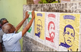 "Opposition presidential candidate Ibrahim ""Ibu"" Mohamed Solih pictured hanging up posters of coalition leaders during his campaign. PHOTO/SOCIAL MEDIA"