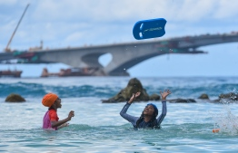 artificial beach children kids playing  swimming male-hulhumale bridge girls