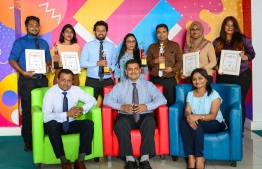 Ooredoo Maldives' CEO Najib Khan (C) poses with other staff for a photograph, after the company won multiple accolades at Asia's Best Employer Branding Awards 2018. PHOTO/OOREDOO