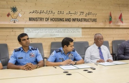 Housing Ministry and the police sign to hand over security of Sinamale and Male Hiyaa flats to Maldives Police Service. PHOTO/HOUSING MINISTRY