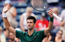Novak Djokovic, of Serbia, celebrates defeating Peter Polansky, of Canada, at the Rogers Cup men's tennis tournament in Toronto, Wednesday, Aug. 8, 2018. (Mark Blinch/The Canadian Press via AP) (Associated Press)