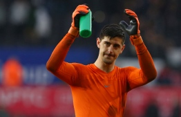 (FILES) In this file photo taken on April 28, 2018 Chelsea's Belgian goalkeeper Thibaut Courtois celebrates their win on the pitch after the English Premier League football match between Swansea City and Chelsea at The Liberty Stadium in Swansea, south Wales. Real Madrid announced on August 8, 2018 the signing of Belgian international goalkeeper Thibaut Courtois for the next six season, from Chelsea, in a statement on its website. / AFP PHOTO / Geoff CADDICK / RESTRICTED TO EDITORIAL USE. No use with unauthorized audio, video, data, fixture lists, club/league logos or 'live' services. Online in-match use limited to 75 images, no video emulation. No use in betting, games or single club/league/player publications.  /
