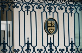 The emblem of the Tokyo Medical University is seen on the building's entance gate in Tokyo on August 8, 2018. A Tokyo medical school on August 7 admitted entrance test scores for female applicants were routinely altered to keep women out and apologised for the discrimination after a probe. / AFP PHOTO / Kazuhiro NOGI
