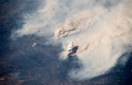 This handout picture obtained from the European Space Agency (ESA) on August 7, 2018 shows a view taken by German astronaut and geophysicist Alexander Gerst, showing wildfires in the state of California as seen from the International Space Station on August 2, 2018. PHOTO | EUROPEAN SPACE AGENCY | AFP