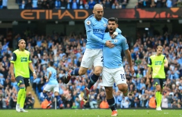 FILE PHOTO: Manchester City's Argentinian striker Sergio Aguero (R) celebrates scoring the opening goal with Manchester City's Spanish midfielder David Silva (L) during the English Premier League football match between Manchester City and Huddersfield Town at the Etihad Stadium in Manchester, north west England, on August 19, 2018. / AFP PHOTO / Lindsey PARNABY /