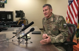 """(FILES) In this file photo taken on March 14, 2018 General John Nicholson, who leads US and NATO forces in Afghanistan, speaks to reporters at Bagram Air Base, about 60km north of the Afghan capital Kabul. The top commander for US and NATO forces in Afghanistan said August 22, 2018 that warring parties now have an """"unprecedented"""" opportunity for peace, and insisted President Donald Trump's strategy for the beleaguered country is working.""""We have an unprecedented opportunity, or window of opportunity, for peace right now,"""" said General John Nicholson, the outgoing commander of NATO's Resolute Support mission.  / AFP PHOTO / Thomas WATKINS"""