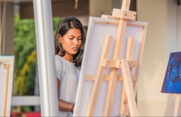 The KULA art initiative was launched on the 5th of October 2017, by Kandima Maldives.Picture shows resident (local) artist Aima Mustafa, who paints and creates art at the resort. PHOTO: KANDIMA MALDIVES.