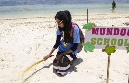 September 1, 2018, L.Maabaidhoo : A student poses with her prop before a performance at the Laamu Turtle Festival 2018. PHOTO: HAWWA AMAANY ABDULLA / THE EDITION