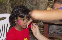 September 1, 2018, L. Maabaidhoo: A child at the face painting stall at the Laamu Turtle Festival 2018. PHOTO: HAWWA AMAANY ABDULLA / THE EDITION